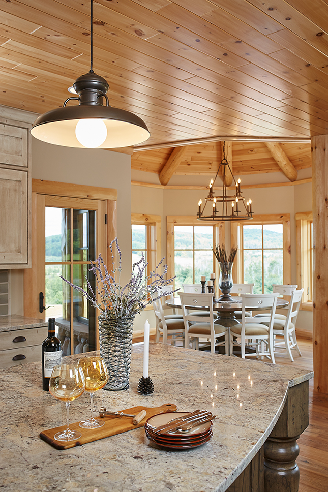 the kitchen inside of a large wooden themed mansion