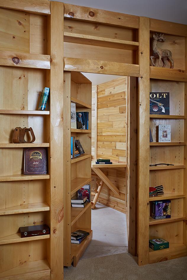 a fake book shelf inside of the hobbs home