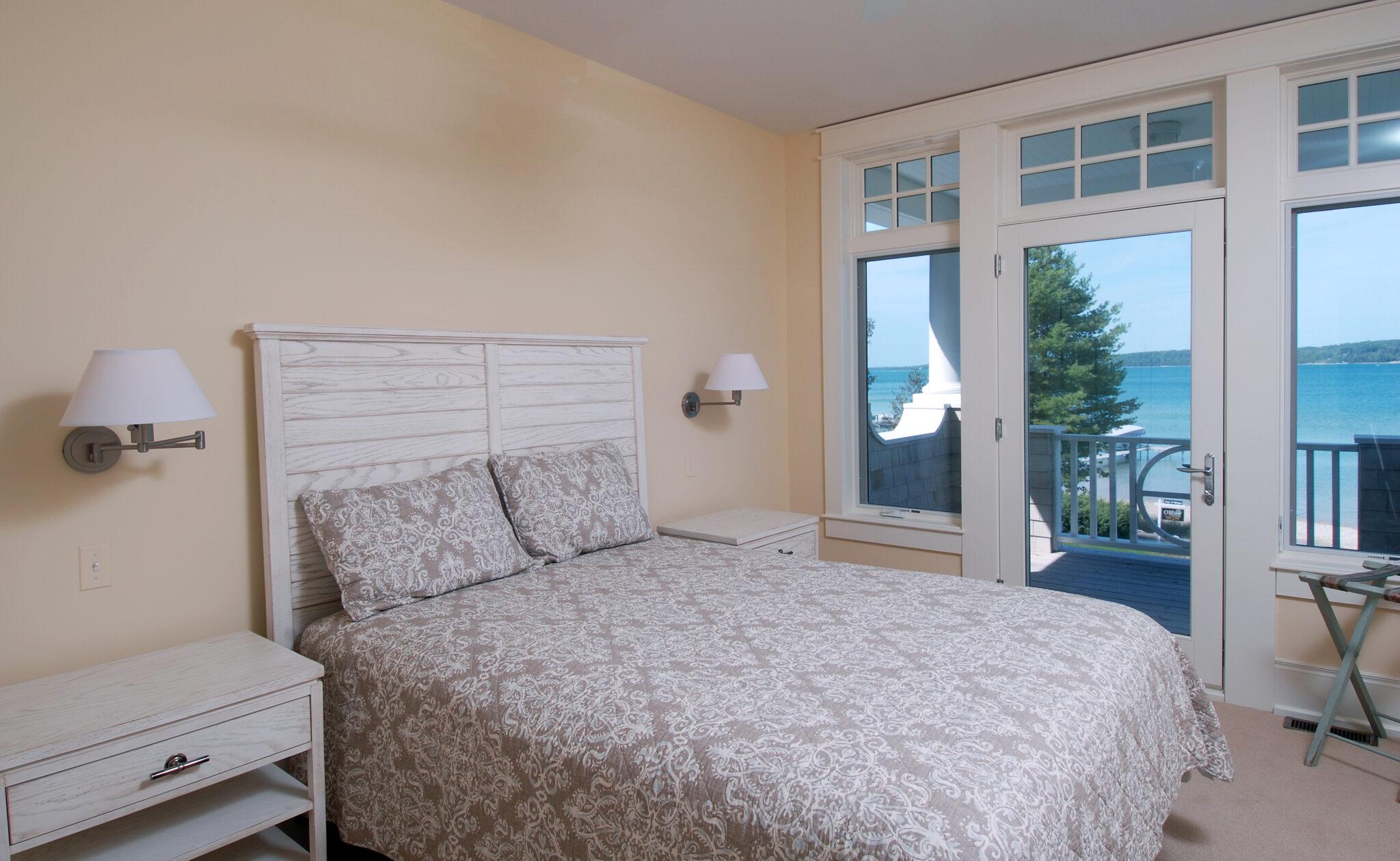 a nice bedroom inside of a charming cedar bay cottage