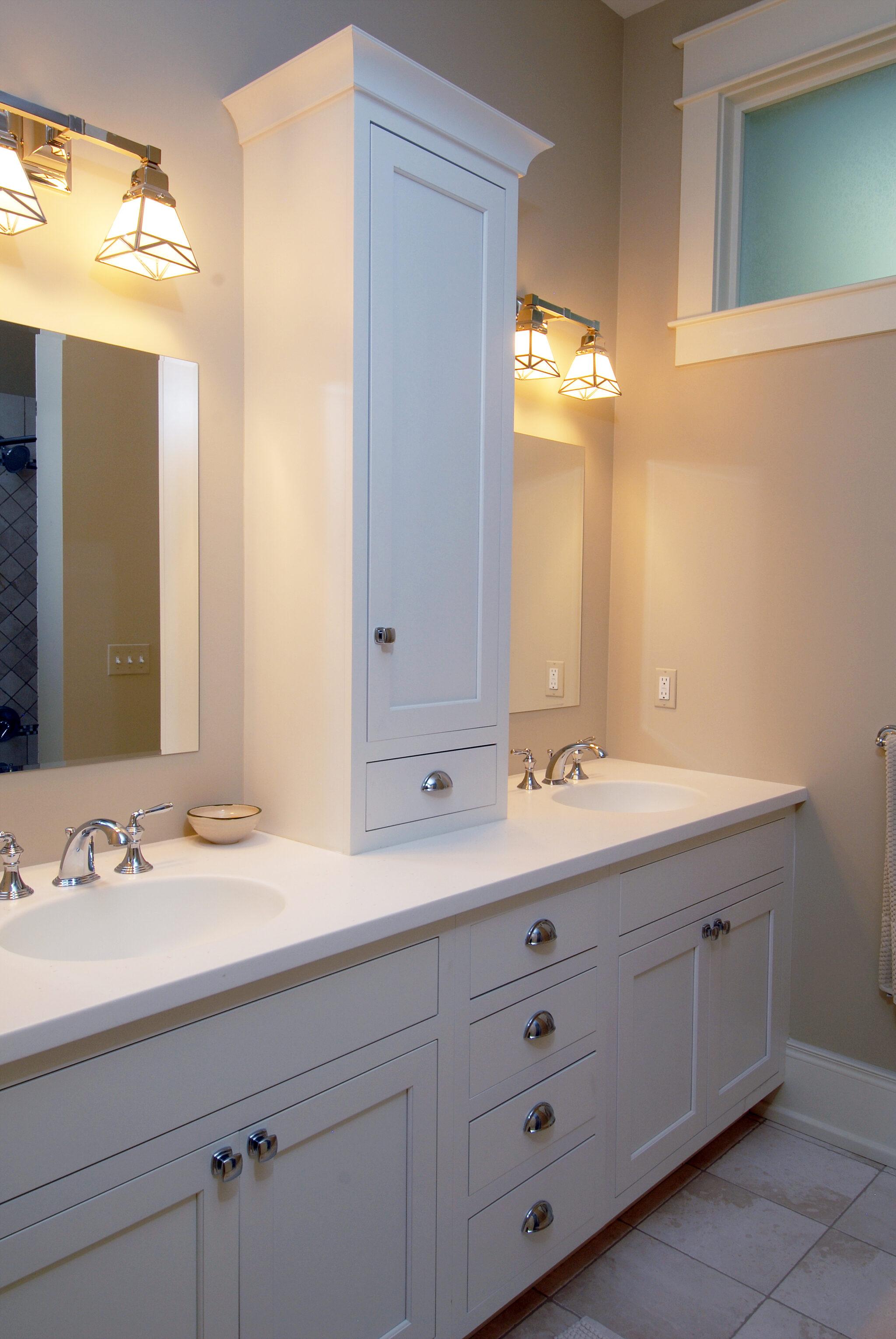 a large 2 sink bathroom inside of a charming cedar bay cottage