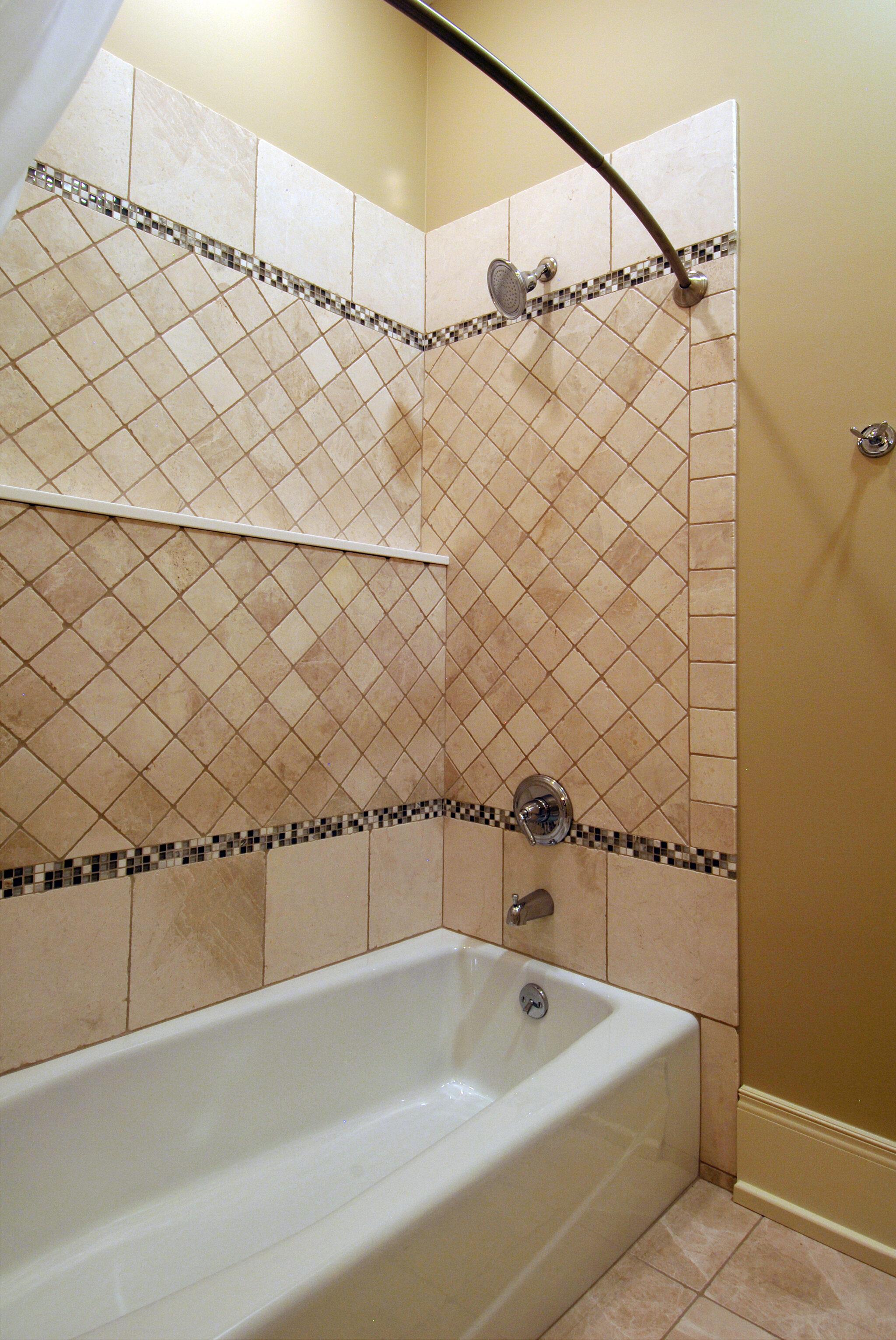 a shower inside of a charming cedar bay cottage