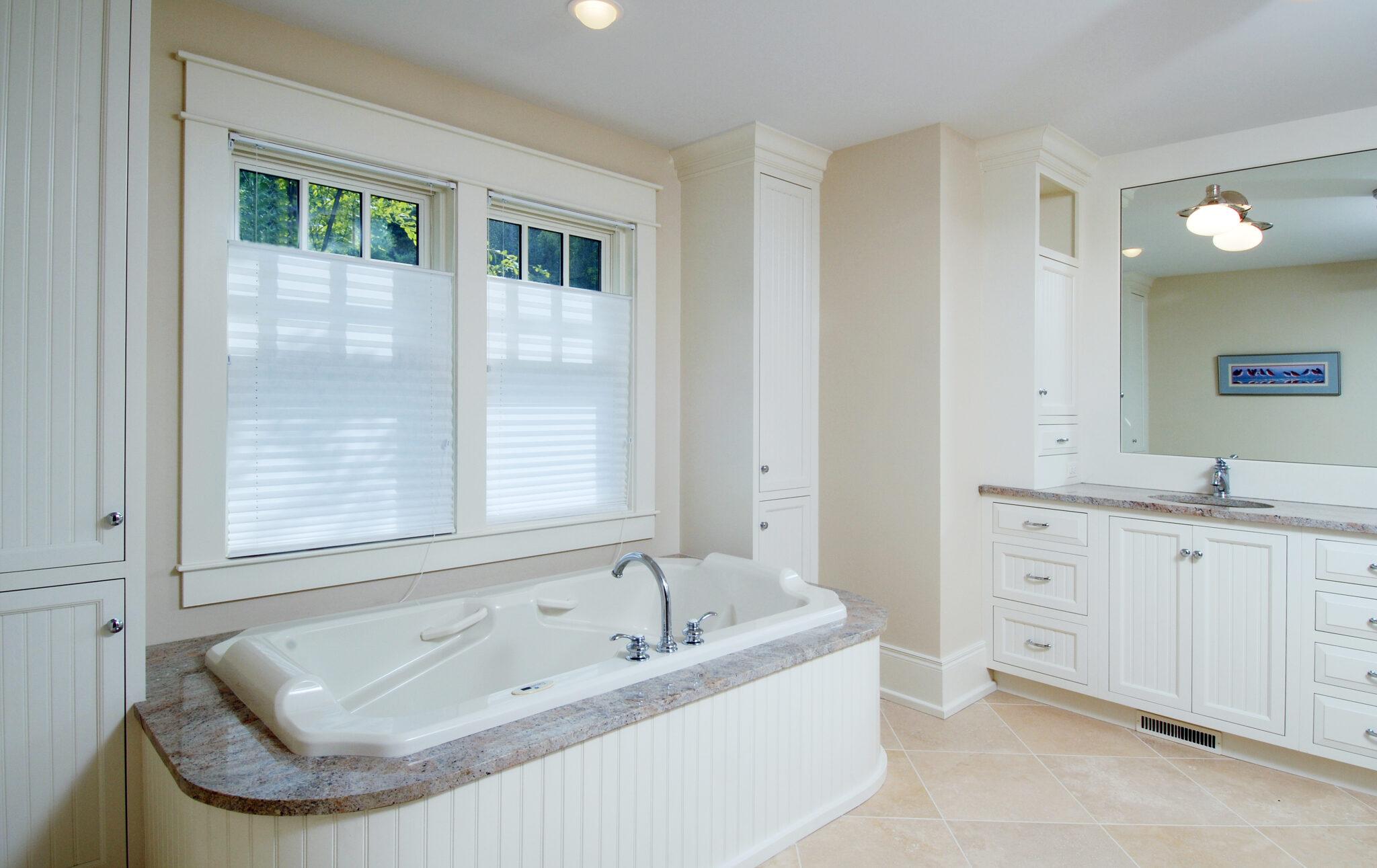 a bath room inside a charming cedar bay cottage