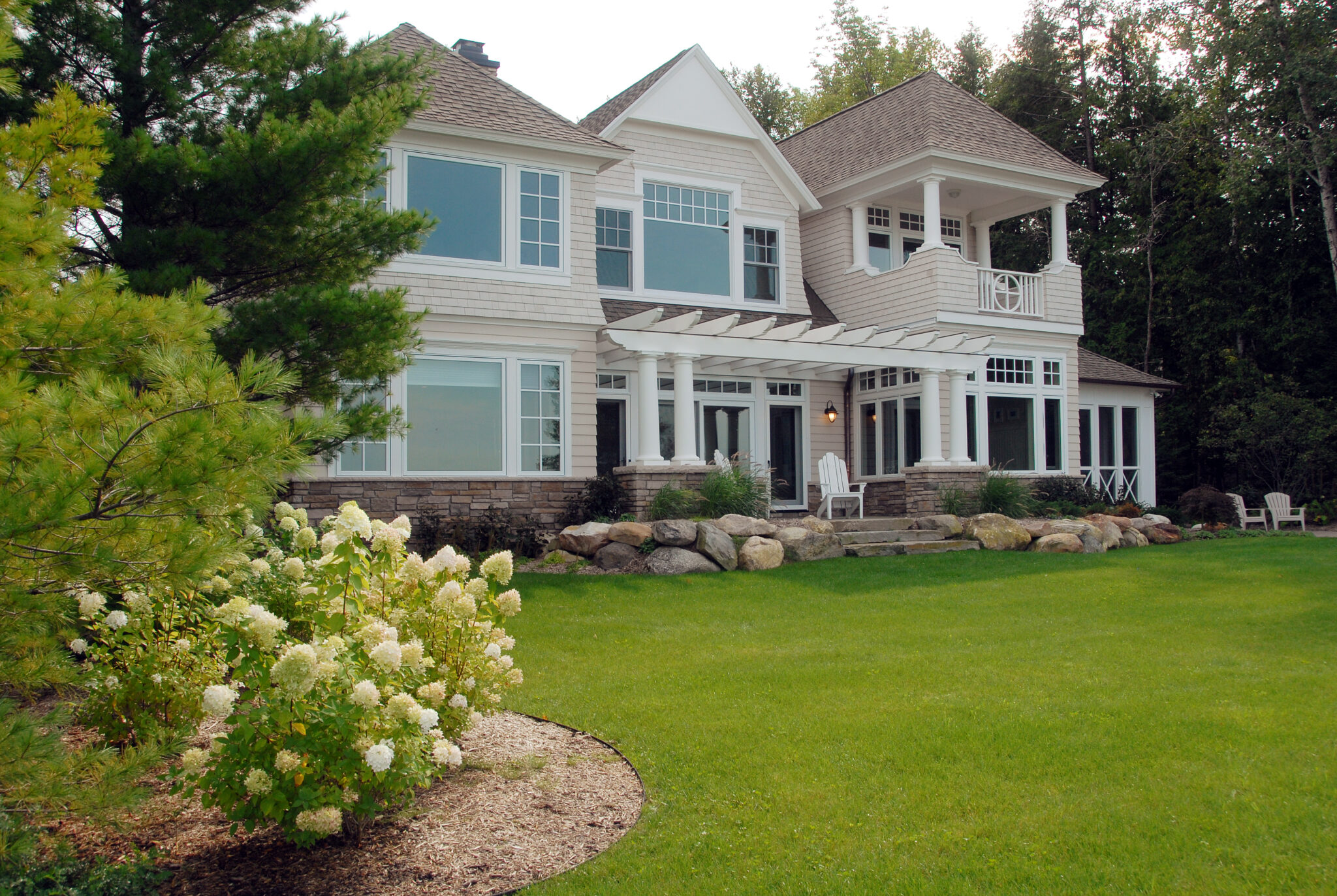 the outside front of a charming cedar bay cottage