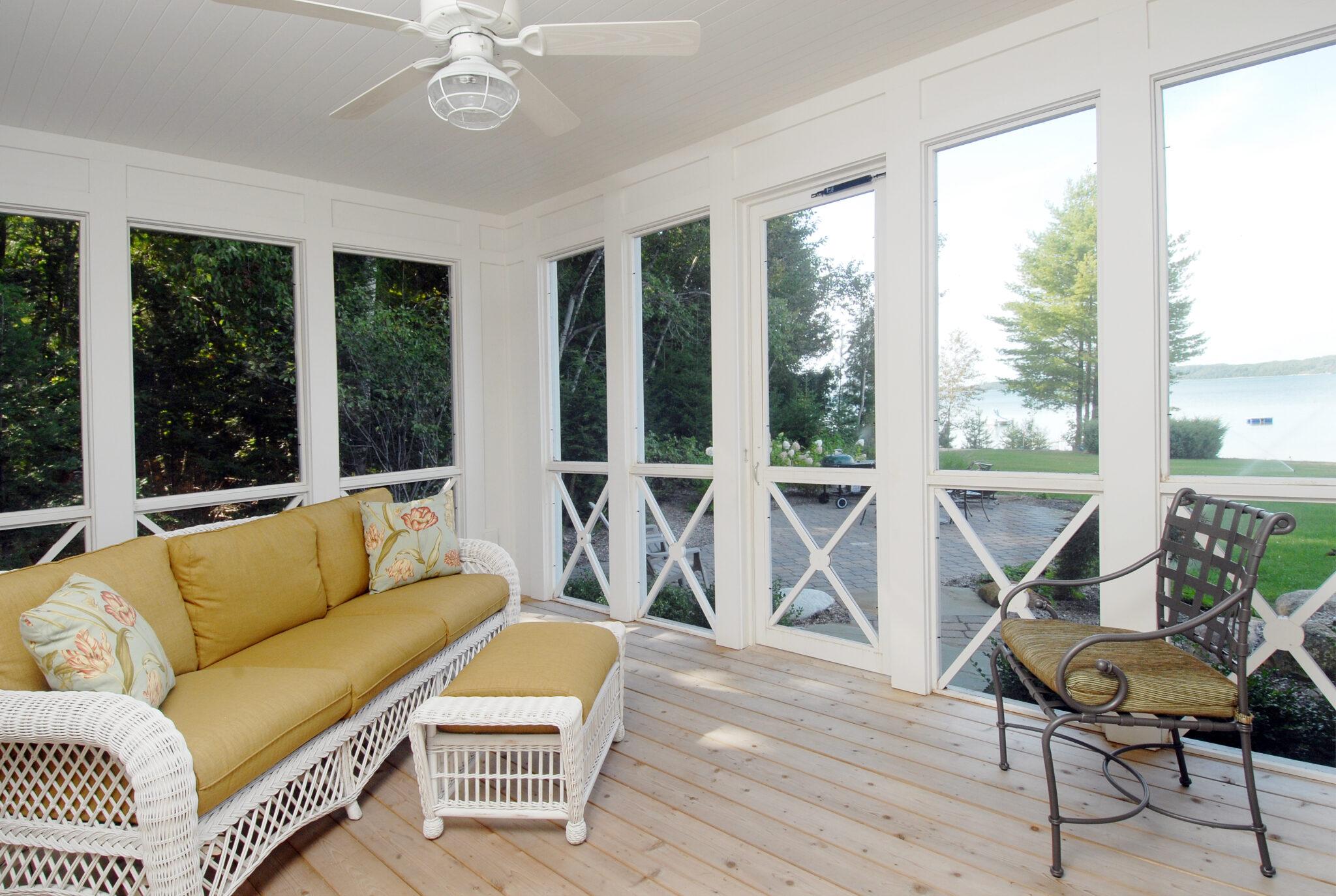 a sun room inside the charming cedar bay cottage