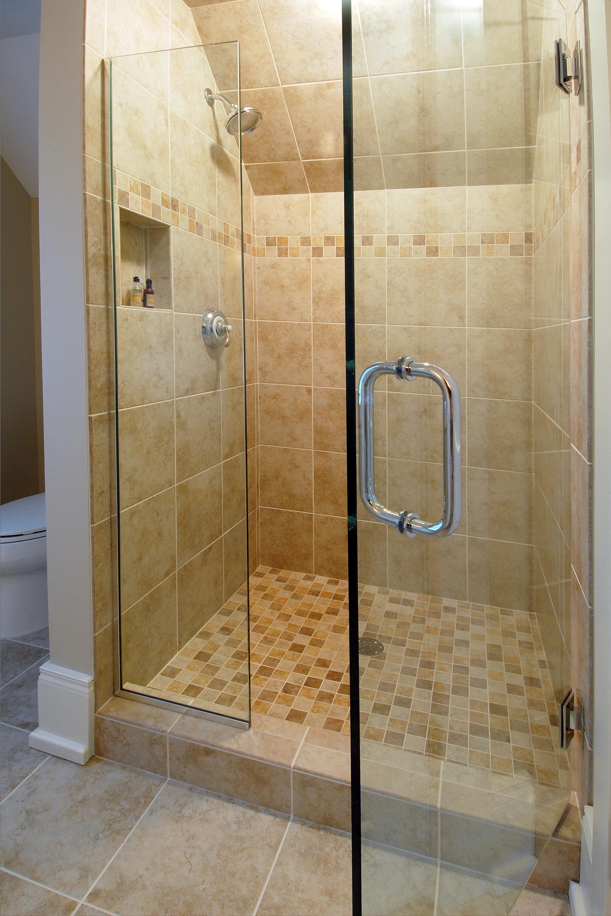 a bathroom shower inside the charming cedar bay cottage