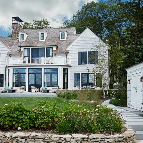 outside of a beautiful glen lake mansion