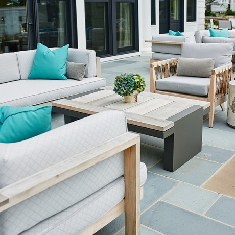 a large patio outside of a beautiful glen lake mansion