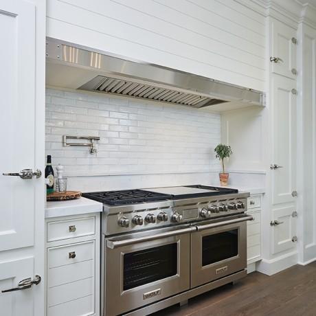 a large kitchen inside of a beautiful glen lake mansion