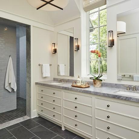 a large bathroom sink inside of a beautiful glen lake mansion