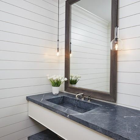 a nice bathroom sink inside of a beautiful glen lake mansion
