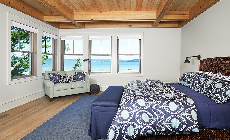 sun lit bedroom inside of a beautiful modern mansion