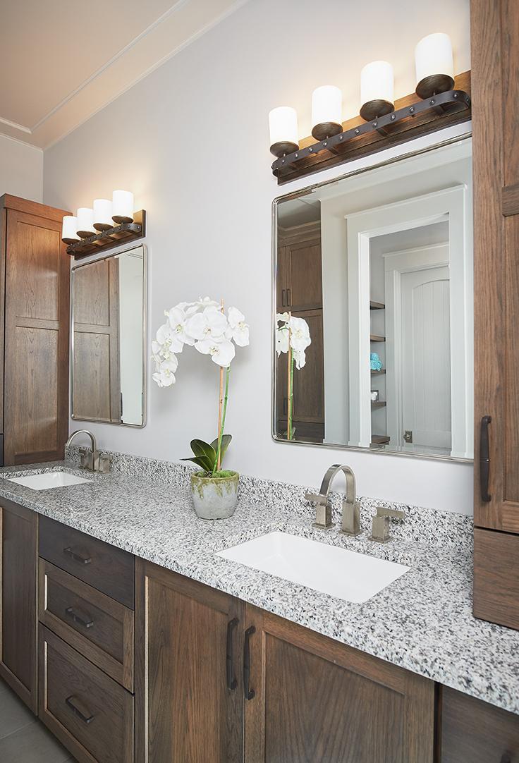 A nice sink in a bathroom inside of a beautiful modern mansion