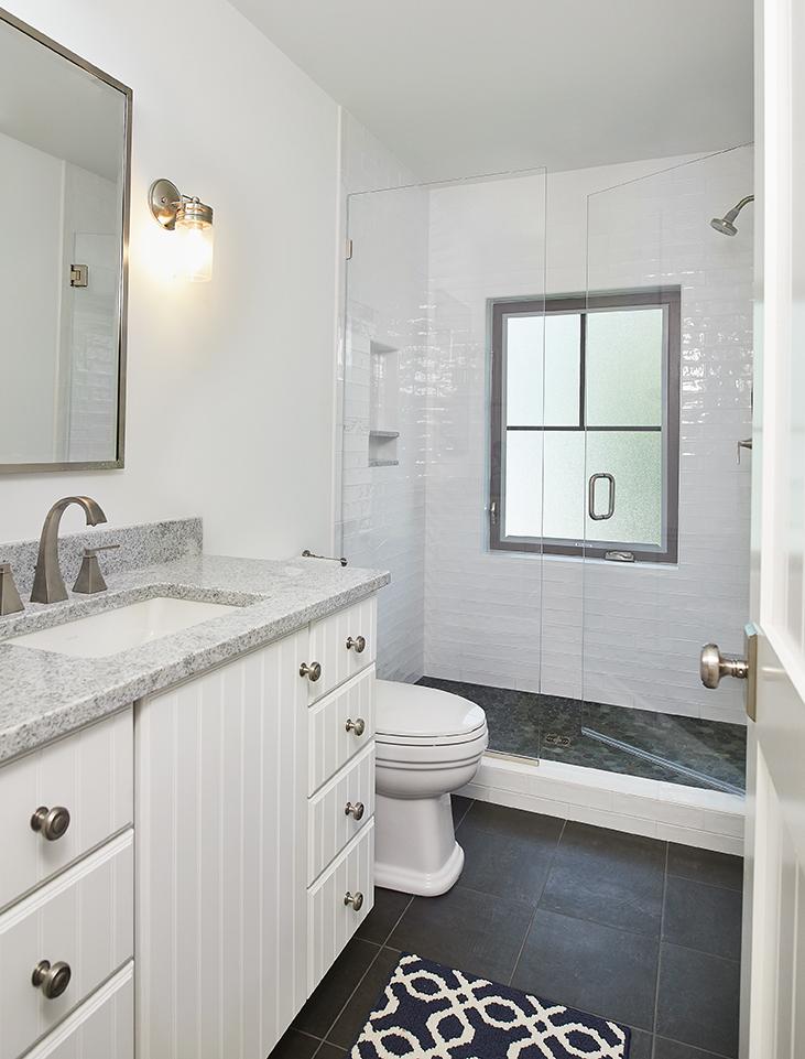 a bathroom inside of a beautiful modern mansion