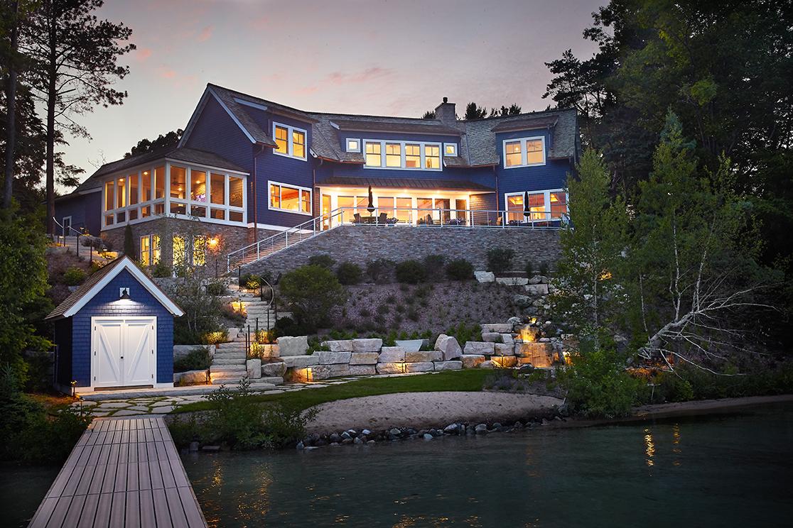 beautiful modern mansion lit up at night