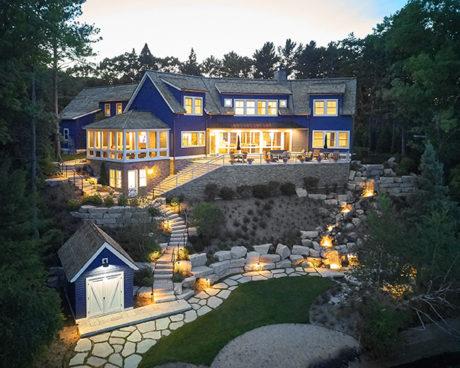 beautiful modern mansion lit up at dawn